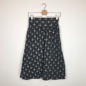 Staring at stars black cross skirt - Size Med